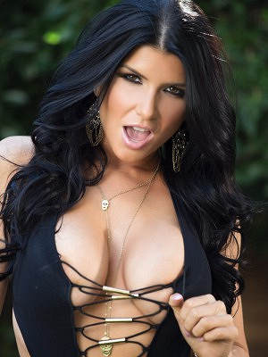 Romi Rain shows off her sexiness outside as she slips out of her bathing suit.