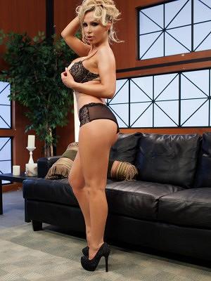 Nikki Benz undressing in her living room.