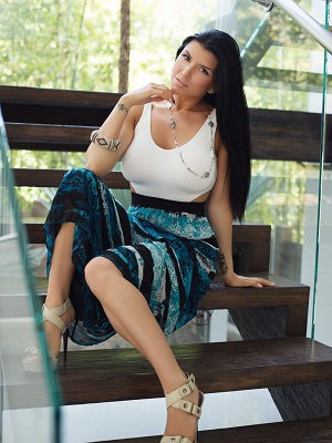 Sexy Romi Rain reveals her huge breasts as she slowly undresses.